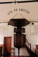 """God is Liefde"" above a pulpit"