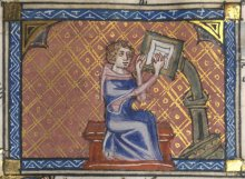Medieval scribe writing at a desk