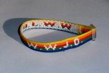 Rainbow coloured WWJD armband.